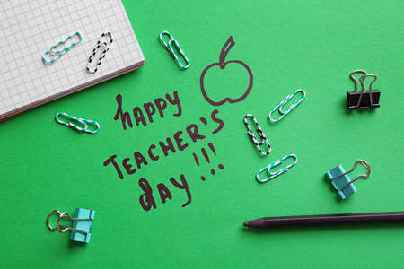 Stationery, text HAPPY TEACHER'S DAY and drawing on paper