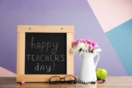 Composition with small chalkboard for Teacher's day on table