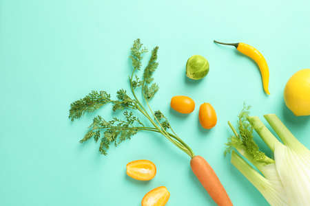 Flat lay composition with fresh fruits and vegetables on color background Stock Photo