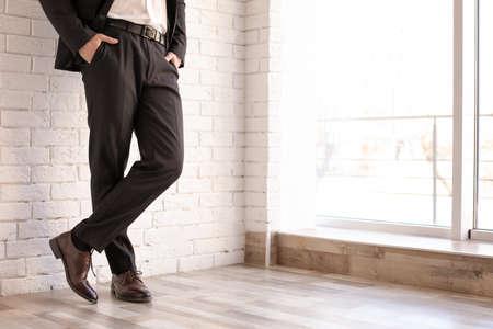 Man in elegant suit and leather shoes indoors, closeup Reklamní fotografie