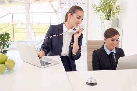 Female receptionists at workplace in hotel