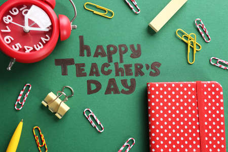 Alarm clock, text HAPPY TEACHER'S DAY and stationery on color paper