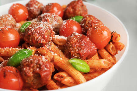 Delicious pasta with meatballs and tomato sauce on plate, closeup Reklamní fotografie