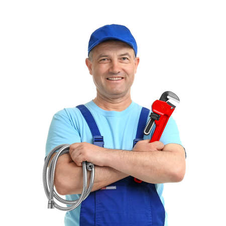 Mature plumber with pipe wrench and hose on white background