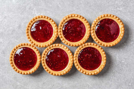 Tasty tartlets with jam on grey background Stok Fotoğraf