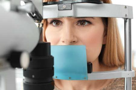 Woman visiting ophthalmologist, closeup