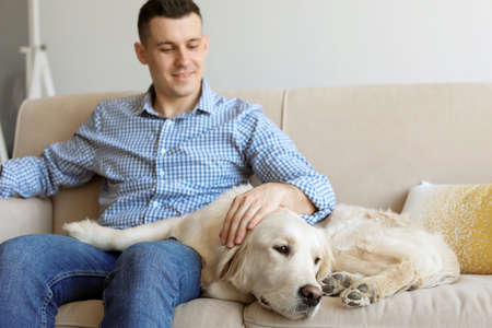 Portrait of owner with his friendly dog at home