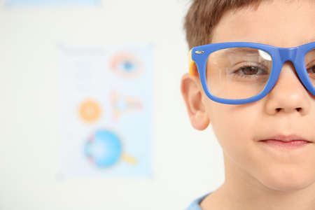 Cute little boy with glasses visiting ophthalmologist