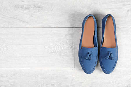 Pair of female shoes on wooden background, top view Stock Photo