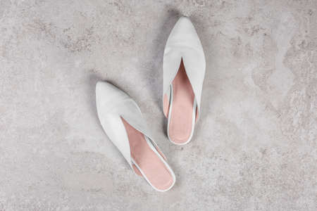 Pair of shoes on gray background, top view
