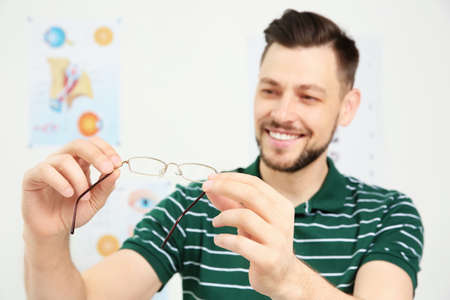 Young man with glasses visiting ophthalmologist