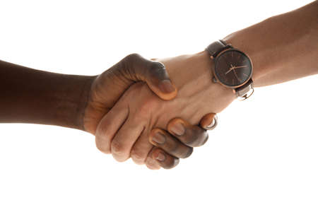 Men shaking hands on light background, closeup. Unity concept