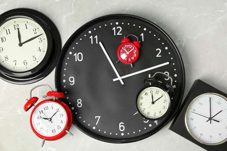 Many different clocks, top view. Time change concept Stock Photo