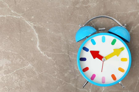 Blue alarm clock on table. Time change concept 스톡 콘텐츠