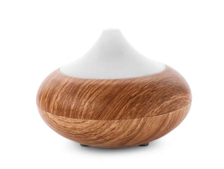 Aroma oil diffuser on white background