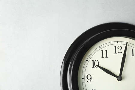 Big black clock on light background. Time change concept