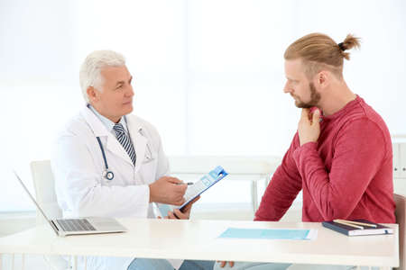 Man with health problems visiting urologist at hospital Stock Photo