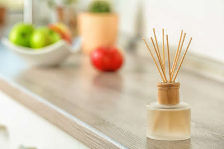 Aromatic reed freshener on table indoors