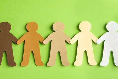 Paper people holding hands on color background, top view. Unity concept Archivio Fotografico