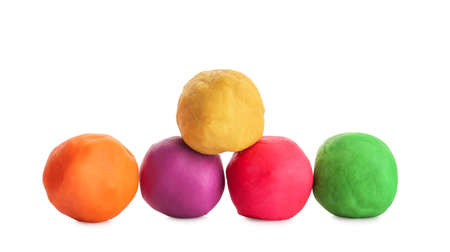 Colorful play dough on white background
