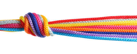 Colorful ropes tied together with knot on white background. Unity concept