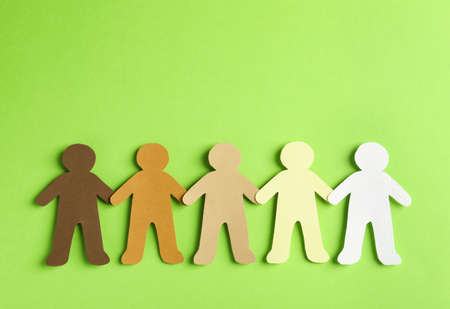 Paper people holding hands on color background, top view. Unity concept 版權商用圖片