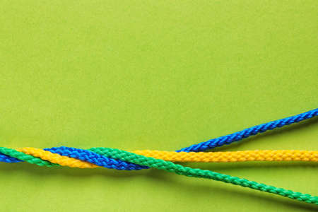 Twisted ropes on color background, top view. Unity concept Stock Photo