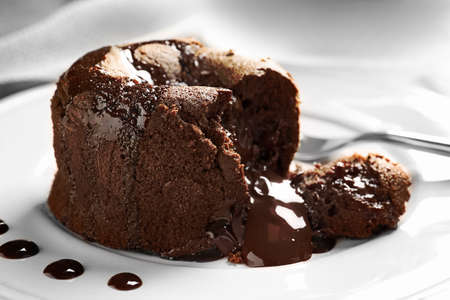 Delicious fresh fondant with hot chocolate served on plate. Lava cake recipe Stock fotó