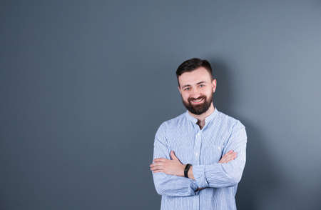 Portrait of handsome bearded man on color background 写真素材