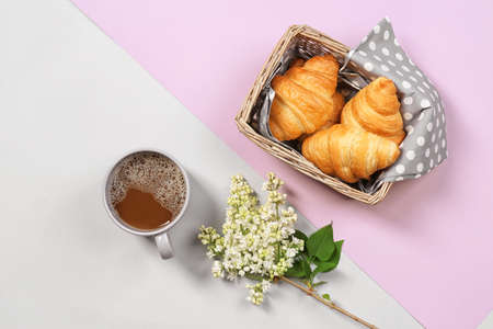 Flat lay composition with tasty croissants and cup of coffee on color background Zdjęcie Seryjne