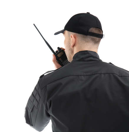 Male security guard using portable radio transmitter on white background 版權商用圖片