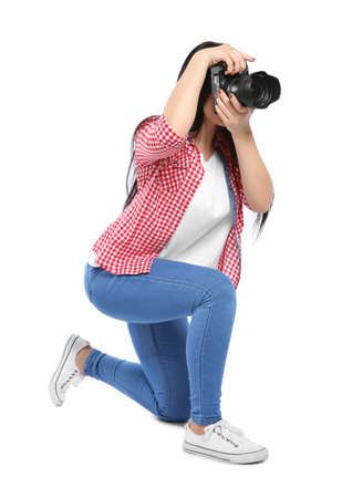 Female photographer with professional camera on white background