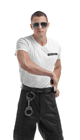 Male security guard with police baton on white background Banque d'images
