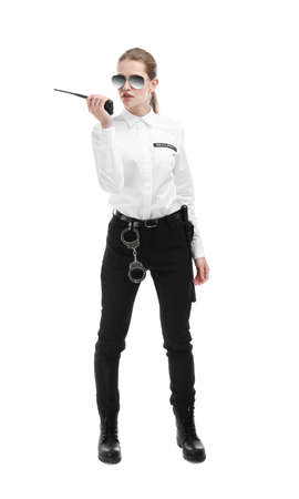 Female security guard using portable radio transmitter on white background