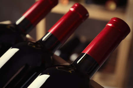 Bottles with delicious wine, closeup. Professional sommelier