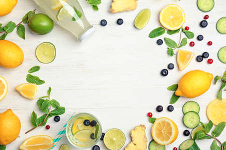 Flat lay composition with delicious natural lemonade on wooden background