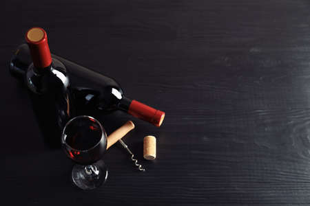 Composition with delicious red wine on wooden table