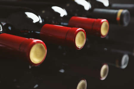 Bottles with delicious wine, closeup Stock Photo