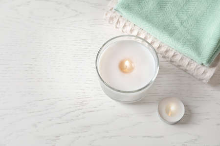 Beautiful composition with burning wax candles on light background