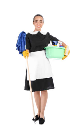 Young chambermaid holding mop and plastic basin with detergents on white background