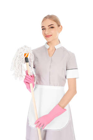 Young chambermaid with mop on white background