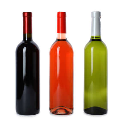 Bottles of expensive wines on white background