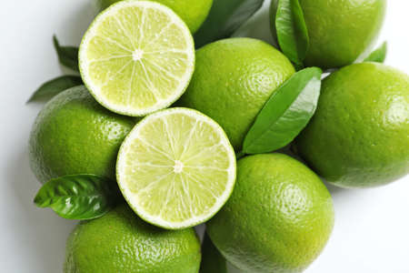 Fresh ripe limes on white background, top view