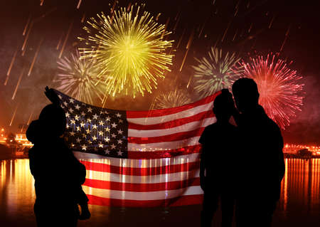 Family with American flag and fireworks in sky. Holiday celebration Stok Fotoğraf