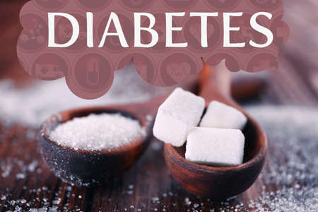 Word DIABETES and spoons with sugar on wooden table 版權商用圖片