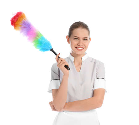 Young chambermaid with dusting brush on white background