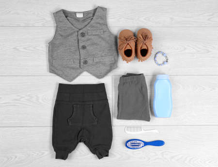 Flat lay composition with stylish child clothes on light background