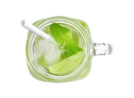 Refreshing beverage with mint and lime in mason jar on white background, top view 스톡 콘텐츠
