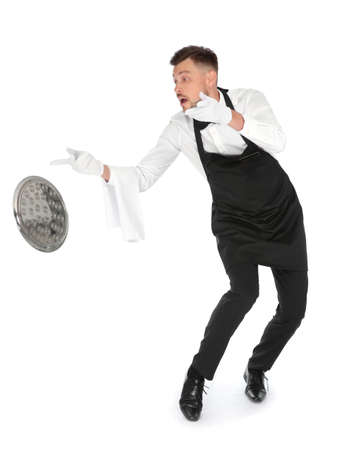 Clumsy waiter dropping empty tray on white background Reklamní fotografie