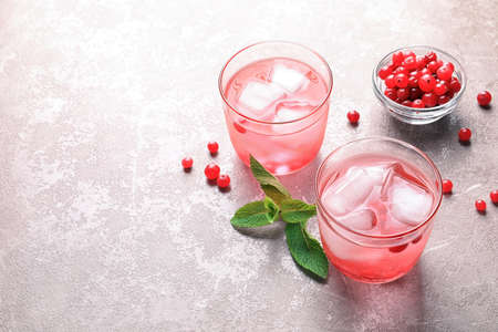 Refreshing natural lemonade in glasses on table Stock Photo
